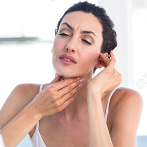 Woman showing her throat to her doctor in medical office